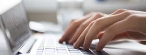 woman typing on keyboard