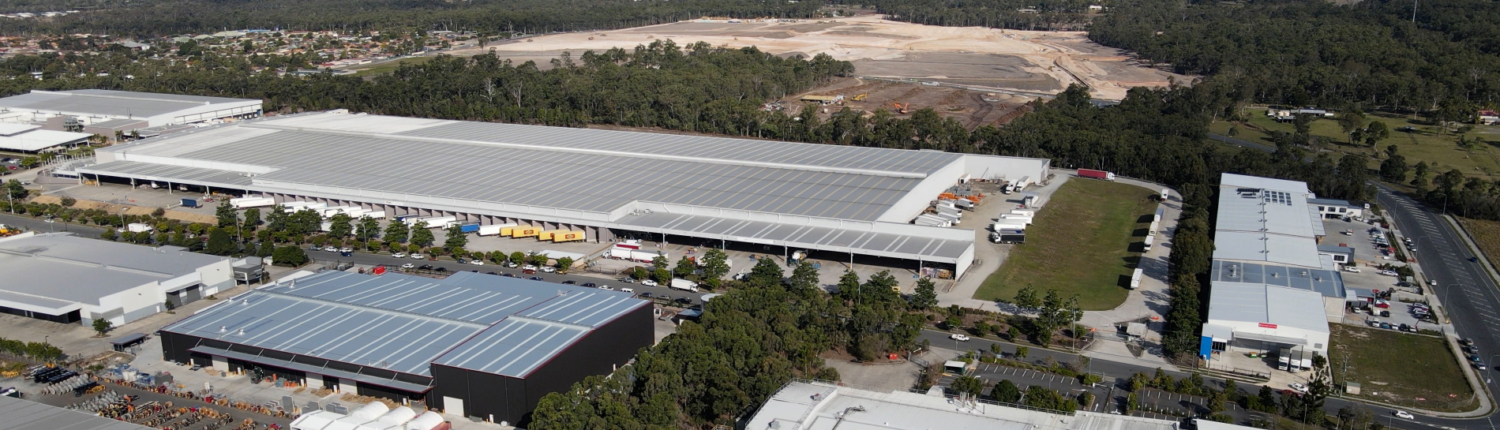 Aerial photo of Metcash warehouse in Crestmead, with land clearing behind it