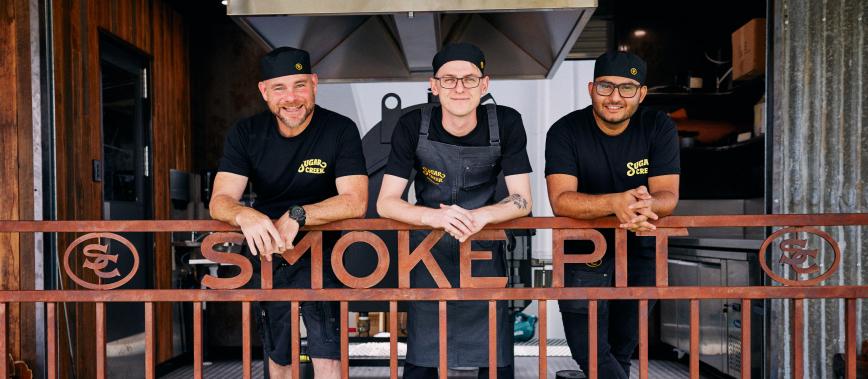 photo of three men at Sugar Creek Smokehouse