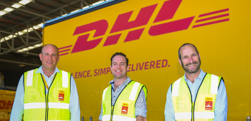 men in front of DHL truck in warehouse