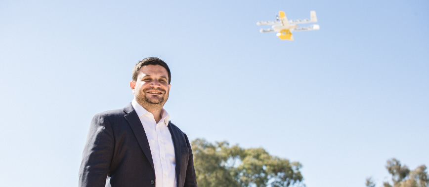 Jesse Suskin from Wing with drone in the sky overhead