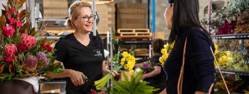 Customer being served at Southside Flower Hub.