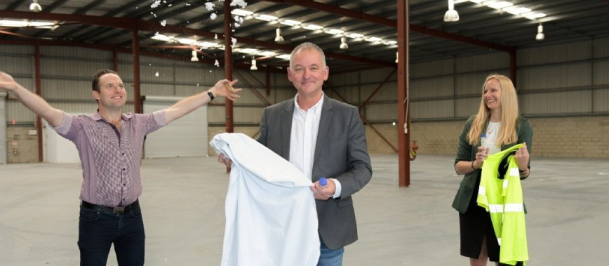 Deputy Mayor Jon Raven with BlockTexx co-founder Graham Ross and local Councillor Miriam Stemp at the company's new headquarters in Loganholme.