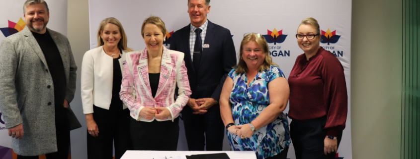 Logan Chamber President Stewart Fleming, Small Business Commissioner Maree Adshead, Minister for Employment and Small Business Di Farmer, Mayor Darren Power, Logan Regional Chamber President Chyerl Pridham, Beenleigh Yatala Chamber President Kerrie Saverin, signing the Small Business Friendly Council charter