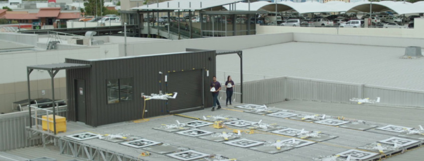 Wing drones launching from shopping centre roof